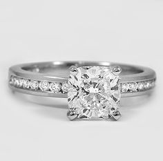 The thin band of this elegant setting features a row of round diamonds suspended in a channel for eye-catching sparkle.