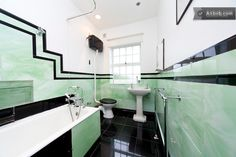 Bathroom with original art deco tiling- big slab tiles with trim