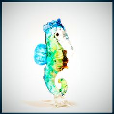 Glass Animal Figurine: a handmade seahorse.  A marine collectible, Sammy is made from strong boro glass in shimmering ocean colors. $12.00, via Etsy.