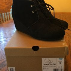 Toms desert wedge in black suede braid Perfect wedge boogie made by toms. Black suede with braided suede detail on sides. Love these!! After an ankle injury cannot wear anymore. Only worn a few times. TOMS Shoes Ankle Boots & Booties