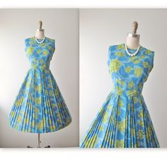 Sweet 60s dress! Features include:    * Classic silhouette  * Floral print fabric  * Full pleated skirt * Back metal zipper  * Skirt is unlined