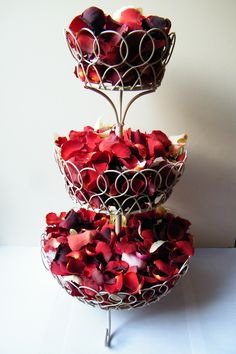 Display your wedding confetti in an unusual way on this cake stand - let guests help themselves to freeze dried rose petals for throwing. Both items from daisyshop.co.uk.