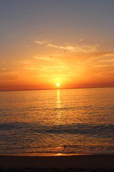 Breathtaking sunset at Praia do Meco, Portugal.