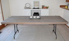 """Okay. Here's a table you can definitely """"build"""" because the structure is already there for you. I saw some banquetolding tables in the free section on Craigslist and my husband and I went to get them to use for the massive garage sale we'll be having in a few months when we sell EVERYTHING (minus…"""