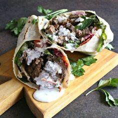 Homemade Doner Kebab Recipe: Make a home version of the classic spit-roasted lamb (doner) kebab, served as a sandwich with vegetables and sauce. Turkish Doner, Turkish Kebab, Doner Kebab Recipe Turkish, Doner Kebab Sauce Recipe, Donair Recipe, Gyro Recipe, Turkish Recipes, Japanese Recipes, Kitchens