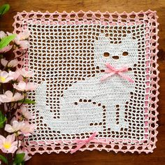 Kitty cat doily, white with a pink border