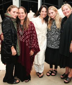 Mary-Kate and Ashley pose with attendees of The Row at A'maree's event in Newport Beach, California.