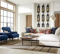 Love hos the lanterns are used on the wall. Caleb Lanterns - Black | Pottery Barn
