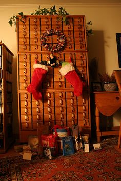 """Christmas condor and card catalog - AFTER,"" by ehoyer, via Flickr -- Me: You know the old poem...""The stockings were hung on the card catalog with care..."""