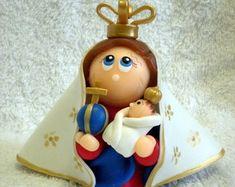 Nossa Senhora de Nazare - 9 cm de altura  http://www.elo7.com.br/atelierclaudiaaparecida