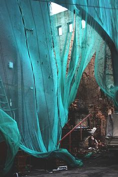 Crumbling building with billowing turquoise fabric, image:  AGiftWrappedLife blog   Not sure of Photographer