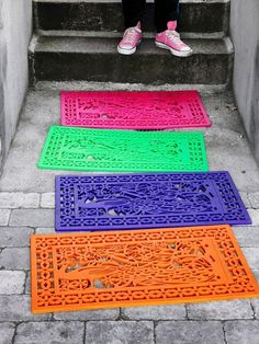 So easy to give a space color!  Spray paint a rubber door mat  to give your front porch or front door a pop of color...