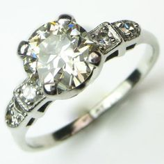 Pretty Lady: An elegant and ladylike solitaire with just the right amount of stylized detail on the shoulders. Ca.1938. Maloys.com