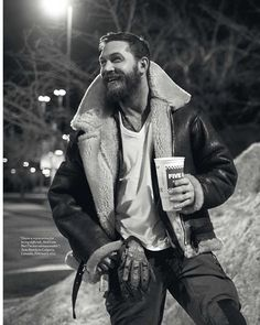 Tom Hardy wearing his Bane jacket and holding a five guys cup. This may very well be the greatest image on earth.