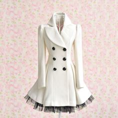 This double breasted pea coat falls into the realm of romantically inspired clothing. The wool coat is constructed in an a-line shape, emphasizing the feminine silhouette with soft pleating and black gauge trim. Winter white with jet black accenting, this pea coat is the perfect dress up piece for colder months.