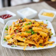 """As they say over on Just Putzing Around the Kitchen, """"there is no problem a pile of crispy fries smothered in melted cheese and crunchy bacon bits can't solve."""" After trying this Bacon Cheese Fries recipe, we definitely agree! It's the perfect. Poutine, I Love Food, Good Food, Yummy Food, Cooking Bacon, Cooking Recipes, Bacon Cheese Fries, Bacon Chips, Bacon Bacon"""