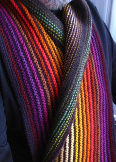 Ridge and Furrow Scarf by Sue Grandfield. Free pattern. A garter stitch ridge to use up leftovers. Designer used 4ply/sock weight yarns held double, or use a single strand of DK weight.