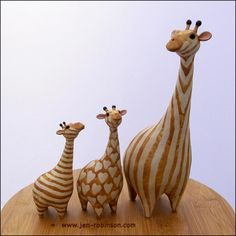 3 hand modelled stoneware giraffes, slip decorated and fired to 1280°C If you like my work maybe you'd like to visit my website gallery My ceramic animals are on facebook too and Google+ ...