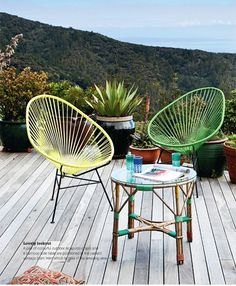 Colourful outdoor chairs and an amazing view - perfect for a glass of vino!