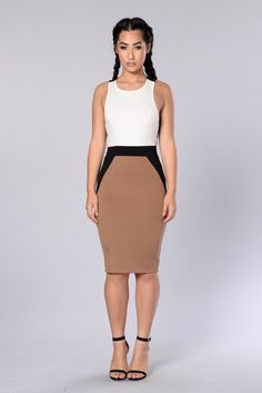 - Available in Ivory/Camel - Color block Sleeveless Dress - X Strap Back Detail - Midi Length - Mini Back Slit - Made in USA - 67% Rayon 29% Nylon 4% Spandex