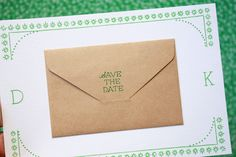 """SAVE THE DATE: A tiny kraft envelope shows through a glassine envelope asking guests to """"save the date"""". All of the wedding information is tucked inside the envelope."""