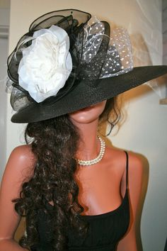 Loving this black and white Derby Hat.