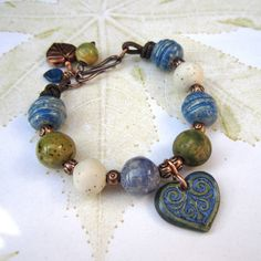 Ceramic bead bracelet, Heart charm bracelet, blue and green beaded bracelet, ceramic bracelet. £30.00, via Etsy.