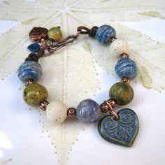 Ceramic bead bracelet, Heart charm bracelet, blue and green beaded bracelet, ceramic bracelet. £30.00, via Etsy.