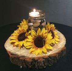 (14) available. Small mason jar filled with neutral stones, water and a floating candle. Sunflower ring around the base on a log round!