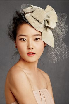 Love this for a departure hat! www.bhldn.com