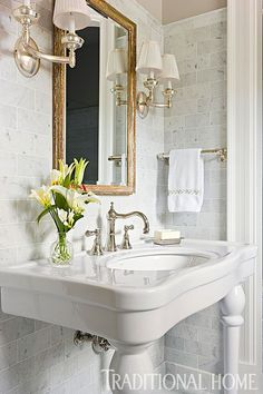Romantic Edwardian style comes to the bath, thanks to a gently curved faucet and sculpted console sink of gleaming porcelain. - Photo: Gordon Beall / Design: Mary Jo Donohoe