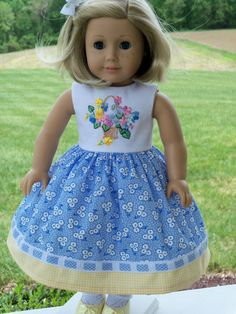 Presenting a beautiful embroidered dress for Kit, Maryellen or your special Be Forever/ Truly Me American Girl Doll. I chose a cheerful Penny Rose cotton fabric called Hope Chest for this cute dress.  The sleeveless bodice is fully lined and is beautifully embroidered with Sulky rayon thread. This stunning embroidery is perfect for summer. The gathered skirt falls below the knee. It is decorated with a contrasting cotton band and blue gingham check insertion lace.  The back of the dress…