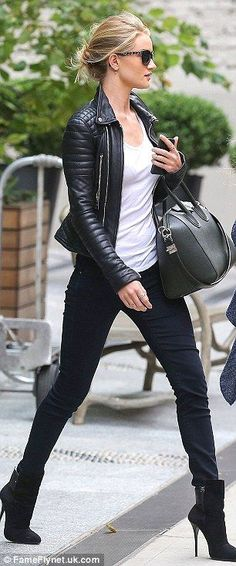 Accessory queen: Rosie teamed the jeans and boots with a white T shirt and a stylish black leather jacket