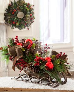 Our Lodge Sleigh Hurricane Centerpiece features a miniature version of Santa's sleigh with jingle bells for embellishment.
