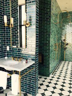 elegant green emerald title + black white tile bathroom luxury
