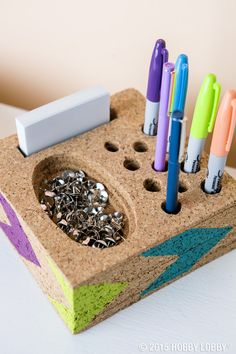 If you're looking to store just what you need and nothing more, build a desk catchall by cutting cork tiles one at a time to fit your supplies. Then, it's as simple as stack, glue and paint!