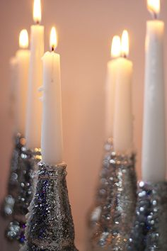 DIY Tinseled Glass Candlesticks. Im gonna try to make these out of all my wine bottles!