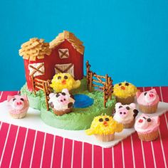 Fun Farm Party animals love the barnyard scene! This one features a pound cake barn and a cupcake silo, and would make the perfect fodder for a party with a baby animal or farm theme.