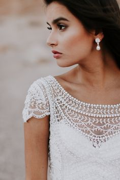 Anna Campbell Bridal ivory hand-beaded Florence Dress with boat neckline and capped sleeves | Worn with the Valencia Pearl Drop Earrings | Photo by Emily Magers