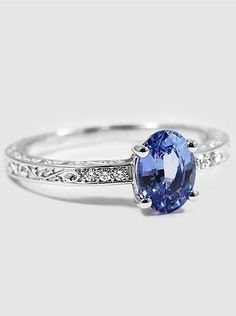 Silver sapphire scroll ring