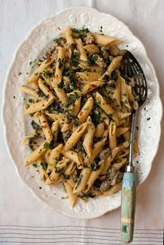 This kale and sausage penne with lemon cream sauce is a dish of strong flavors: dark, earthy kale is offset by bright lemon cream and a warm, aromatic heat from crushed red chiles and garlic.