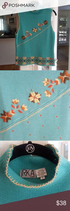IRKA Silk Cowl neck sweater Never Worn! Beautiful tan embroidery around the collar and sleeve openings. Embroidered flowers of tan, brown and orange on a teal background. Will look amazing under a jacket or furry vest, or alone! Sweater is 75% silk with cotton.  There is a slight loop out of place but can be pulled back through...fabric is not torn. Will fit XS, S, or M IRKA by SSG Tops