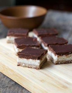 "No-Bake Almond Joy Bars (Vegan, Paleo) Featuring a grain-free almond ""cookie"" crust, a quick coconut filling, and a rich chocolate topping, these bars are hard to resist!"
