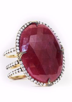 Sylva & Cie's 18k yellow gold size 7 ring set with a center oval 24.38ct faceted raw ruby stone accented with 1.35ctw sparkling white diamonds.