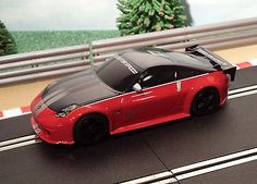 For sale Scalextric 1:32 D... One careful owner! Browse here http://www.actionslotracing.co.uk/products/scalextric-1-32-drift-car-red-need-for-speed-nissan-350z?utm_campaign=social_autopilot&utm_source=pin&utm_medium=pin