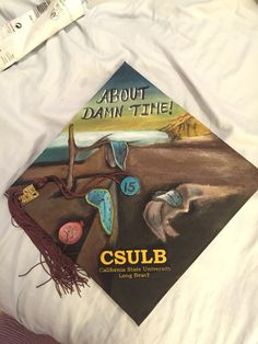 Grad cap design I painted for my Graduation from CSULB in Art History