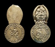 Seal-die of Godwin and Godgytha.  Walrus ivory.  Late Anglo-Saxon, early 11th c.  Wallingford, Oxfordshire.  L 86mm. + SIGILLVM GODEGYÐE MONACHE DŌDATE The seal of Godgyða, a nun given to God.   + SIGILLVM : GODÞINI MINISTRI  The seal of Godwin the thegn.  British Museum.
