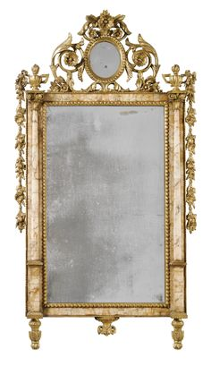 An Italian marble-mounted carved giltwood mirror, Sicilian or Spanish, late 18th century.