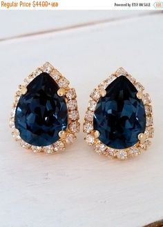 Navy Blue earrings, Stud earrings, Navy blue studs, Swarovski earrings, Bridal earrings, Bridesmaid gift, deep blue earrings, Gold Silver  Elegant and refined.  These earrings are so sparkly. They would be great as bridal earrings or for any other day. Perfect gift for bridesmaids or other occasions.  They are made of 14k gold plated brass posts and Swarovski crystals, all set in prong setting.  Made with CRYSTALLIZED™ - Swarovski Elements  Each teardrop is approx. 19 x 15 mm   AVAILABLE AS…