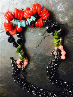 A series of loops made with beading wire and crimps bring all of @tesoritrovati 's Bead Gallery beads from @michaelsstores togther!